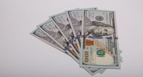 One hundred dollars of banknotes isolated on a white background.  Royalty Free Stock Photography