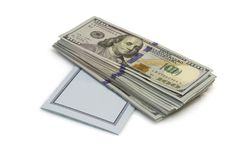One hundred dollars banknotes lie on checkbook isolated on white background Stock Images