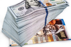 One hundred dollars banknotes with one hundred shekels Stock Images