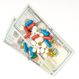 One hundred dollars banknotes and pill isolated on. White background Stock Photos