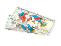 One hundred dollars banknotes and pill isolated on. White background Stock Images