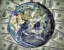 Global economy - World globe on dollar background Royalty Free Stock Photography