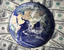 One hundred dollars bill with earth world Economic recovery. 100 $ dollars bill with earth on top financial Economic recovery concept an earth with dollars royalty free stock image