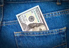 One hundred dollars bill sticking out of the jeans pocket Stock Photography