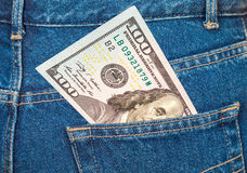 One hundred dollars bill sticking out of the jeans pocket Royalty Free Stock Images
