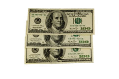 One hundred dollars bills isolated on white. One hundred dollars bills isolated on a white background Royalty Free Stock Photo