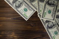 One hundred dollars bills on wooden desk. Top view, copy space Stock Photo