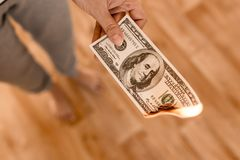 One hundred dollars burn in flames in hand Royalty Free Stock Photos