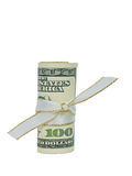 One Hundred Dollars Cash Rolled with a Ribbon. A single US Hundred Dollar Bill rolled and tied with a white and gold ribbon Royalty Free Stock Photos