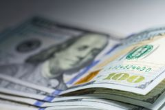 One hundred dollars close up with selective focus and spot light Stock Photo