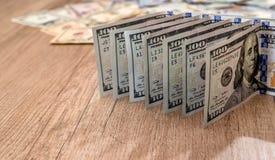 One hundred dollars on desk Stock Photo
