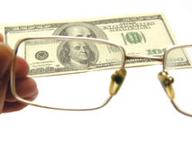One hundred dollars and eyeglasses Stock Photography