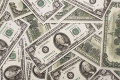 One hundred dollars federal reserve notes. Federal reserve notes dispersed in a chaotic order Stock Photo
