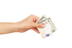 One hundred dollars and Fifty euro in the woman`s hand Stock Photos
