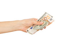 One hundred dollars and Fifty euro in the woman`s hand Royalty Free Stock Photos