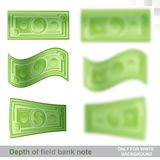 One hundred dollars flat banknotes in different position with sharp and depth of field effect. On white Stock Photography