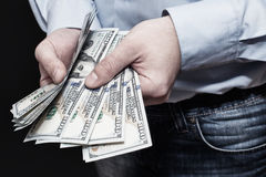 One hundred dollars in hand. Businessman shows money. Royalty Free Stock Image