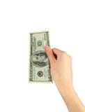 One hundred dollars in hand. Concept of cash. One hundred dollars in hand on white background Stock Image