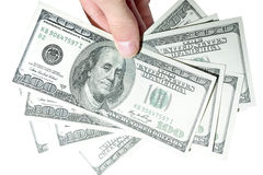 One Hundred Dollars in hand Stock Photography