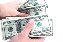 One Hundred Dollars in hand Royalty Free Stock Photos