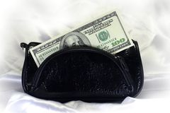 One hundred dollars in leather purse. Royalty Free Stock Photos