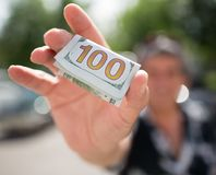 One hundred dollars in a man`s hand Royalty Free Stock Photos