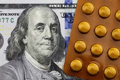 Medicines on the dollar. One hundred dollars and medicines Royalty Free Stock Photography