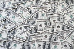 One hundred dollars notes background Stock Photos