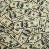 One hundred dollars pile as background. Royalty Free Stock Photo