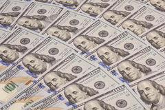One hundred dollars pile Royalty Free Stock Photo