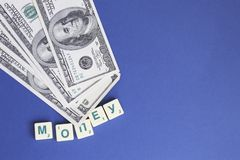 One hundred dollars pile as background. Copy space stock image
