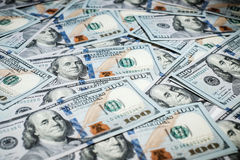 One hundred dollars pile as background Stock Images