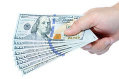 One hundred dollars pile on hand Stock Image