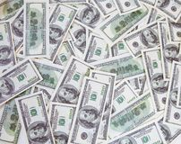 One hundred dollars pile Stock Photo