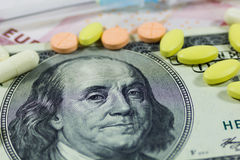 One hundred dollars and pills Stock Images