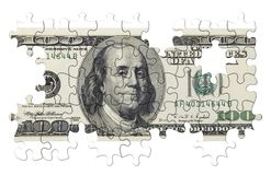 One hundred dollars puzzle(isolated). USA banknote as concept for US dollar fall(special photo f/x Stock Photo