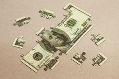 One hundred dollars puzzle. Photo concept Royalty Free Stock Photos