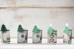 One hundred dollars rolls with clothespins decorated Christmas t Stock Photography