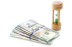 One hundred dollars with sand clock Stock Images