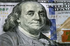 One Hundred Dollars. Selective focus on Benjamin Franklin eyes. Royalty Free Stock Photos