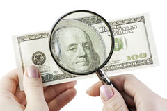 One hundred dollars under magnifier Royalty Free Stock Photo