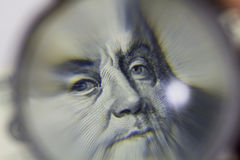One hundred dollars under the magnifying glass Stock Photos