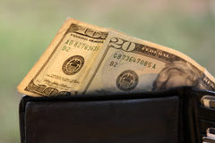 One hundred dollars in a wallet Stock Photo