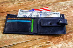 One hundred dollars in the wallet and the American flag. Stock Image