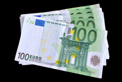 One hundred euro. Five bills on one hundred euro on black background Royalty Free Stock Photos