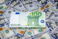 One hundred euro on american dollars money background Royalty Free Stock Photo