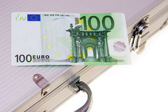 One hundred euro banknote an aluminum suitcase. Isolated on white Royalty Free Stock Photos