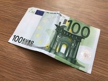 One hundred euro banknote on a light background. 100 Euro banknote on a light background royalty free stock photos
