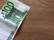 One hundred euro banknote on a light background. 100 Euro banknote on a light background stock image