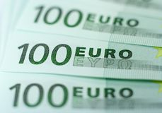 One Hundred Euro Banknotes. Close-up of three 100 Euro bills with shallow depth of field isolated on a white background Royalty Free Stock Photo